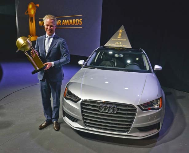 Scott Keogh, President of Audi America, holds his trophy after the A3 was named World Car of the Year.